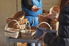 Trade at the market with wicker baskets stock images