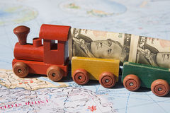 Trade with North America. A toy train, loaded with US dollars going to North America.  The concept is trade between nations, international trade.  The train Royalty Free Stock Photo