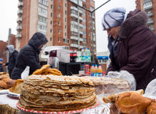 Trade pancakes on city streets on celebrating of Maslenitsa. Sosnovy Bor, Russia - March 13, 2016: Trade pancakes on city streets on celebrating of Maslenitsa Royalty Free Stock Photography