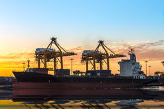 Trade Port. Bic commercial ship in import,export pier use for vessel transport business industry and cargo ,freight ,shipping port Royalty Free Stock Photo