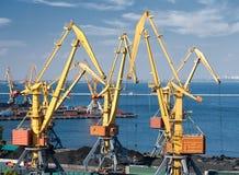 Trade port and cranes Stock Photos