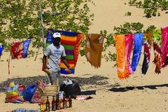 Trade in Portuguese island in Mozambique. Salesman on the beach of Portuguese island in Mozambique, Africa Stock Photos