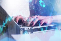 Trade and profit concept. Hands using laptop with abstract forex chart. Double exposure Royalty Free Stock Photos
