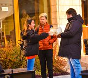 Trade purebred pigeons - pigeons fan from Irkutsk with tourists from Japan on the street, in the city of Irkutsk, 130 quarter, Oct. Girl and guy from Japan got stock photos