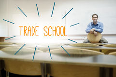 Trade school against lecturer sitting in lecture hall Stock Images