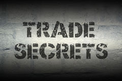 Trade secrets GR. Trade secrets stencil print on the grunge white brick wall Royalty Free Stock Image
