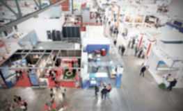Trade show background with an intentional blur effect applied Stock Image