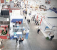 Trade show background with an intentional blur effect applied Stock Images