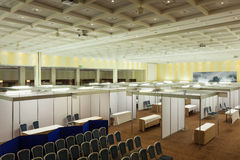 Trade show interior. With booth and tables stock image