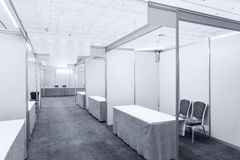 Trade show interior. With booth and tables stock photo