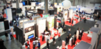 Trade show people, intentionally blurred background Royalty Free Stock Image