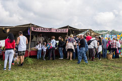 Trade Slavic household items at the festival of historical clubs in the Kaluga region of Russia. Royalty Free Stock Photos