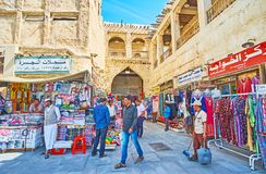 Trade street in Souq Waqif, Doha, Qatar. DOHA, QATAR - FEBRUARY 13, 2018: The trade street of  old preserved Souq Waqif, famous for its authentic architecture Stock Photo