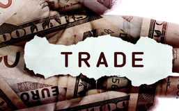 Trade. Text on a paper scrap over world currency Stock Photography