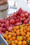 Trade in the vegetable market in Europe, ripe garnets and tangerines on the counter.  Royalty Free Stock Photo