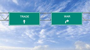 Trade and war. Road signs to trade and war Stock Photography