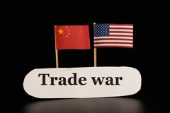 A trade war between USA and China. Conflict between west and east. Black background stock photo