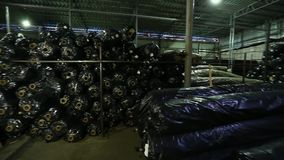 Trade warehousing and shipping the rolls of mesh for road surfacing. Production trade warehousing and shipping of road surface mesh rolls stock footage