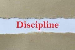 Discipline heading. Typed discipline heading behind torn paper stock photo