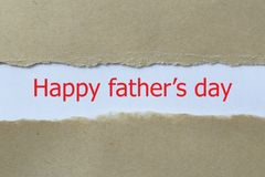 Happy father's day heading. Happy father's day heading behind ripped paper stock images