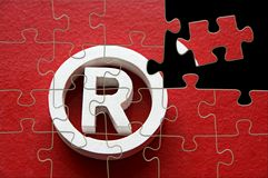 Trademark. Registered trademark in a red background - puzzle Stock Photography