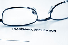 Trademark application. Close up of glasses on Trademark application stock photo