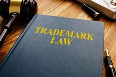 Trademark law and gavel on wooden surface. Copyright concept. Trademark law and gavel on a wooden surface. Copyright concept royalty free stock photography
