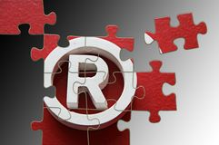 Trademark puzzle. R Registered trademark - puzzle incomplete - illustration in gray background Royalty Free Stock Images