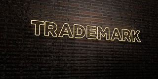 TRADEMARK -Realistic Neon Sign on Brick Wall background - 3D rendered royalty free stock image Royalty Free Stock Photography