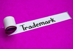 Trademark text, Inspiration, Motivation and business concept on purple torn paper royalty free stock photo