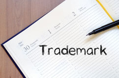 Trademark write on notebook Stock Photos