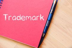 Trademark write on notebook. Trademark text concept write on notebook with pen royalty free stock photos