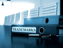 Trademarks on Ring Binder. Toned Image. 3D. Binder with Inscription Trademarks on Desktop. Trademarks - Business Concept on Blurred Background. Trademarks Stock Photos