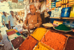 Trader of exotic and colorful incense with sweet smell on city market place Royalty Free Stock Photo