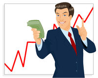 Trader holding bundle of money Stock Photo