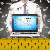 Trader holding laptop with crisis chart Stock Photography