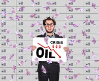 Trader holding poster with statistics fall in oil prices Royalty Free Stock Photography
