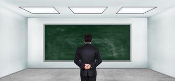 Trader looking on blank blackboard Stock Photos