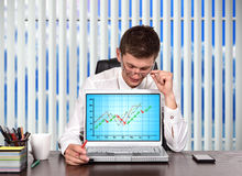 Trader  looking on stock chart Stock Photography