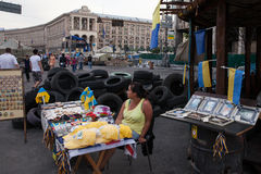 Trader of revolutionary souvenirs on Maidan Royalty Free Stock Photos
