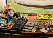 Trader's boats in a floating market in Thailand. Royalty Free Stock Image