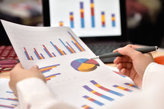 Trader Woman analyzing income charts. Stock Images