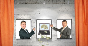 Traders with cool money notebook on frames on wall stock photo