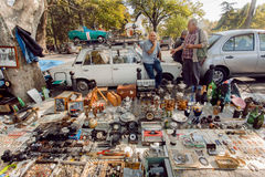 Traders of flea market having a lot of vintage cameras, souvenirs, toys and retro staff for customers Royalty Free Stock Photos
