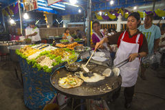 Traders at the night market in Thailand stock photo