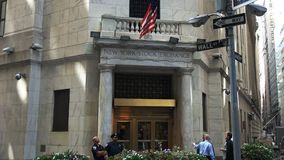 Traders outside the Stock Exchange on Wall Street, NYC. Traders outside the exterior to the Stock Exchange on Wall Street in New York City stock video footage