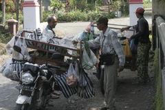 TRADERS VEGETABLES USING MOTORCYCLE TOUR. Vegetables are sold above the basket vegetable traders wandering over the countryside using modern motorcycle Puhgogor Royalty Free Stock Images