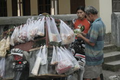 TRADERS VEGETABLES USING MOTORCYCLE TOUR. Vegetable traders wandering over the countryside using modern motorcycle Puhgogor serve buyers in the village Stock Image