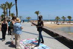 Traders on the waterfront Torrevieja Stock Photos