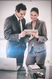 Trades partner looking at tablet in their hands Stock Images